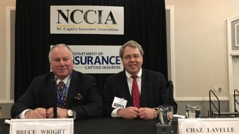 Bruce Wright and Chaz Lavelle Sitting At NCCIA Booth