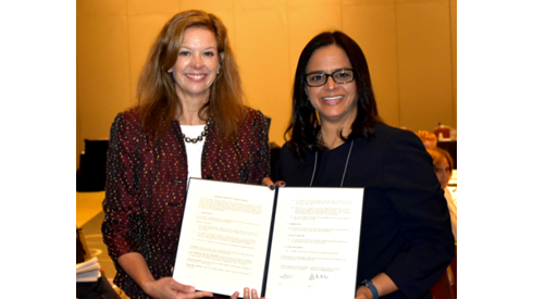 CIMA MOU Two Women Holding Signed Document