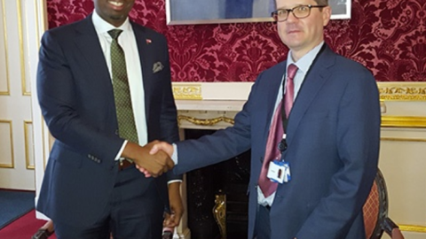 Two representatives signing the Bermuda-UK Competent Authority Agreement
