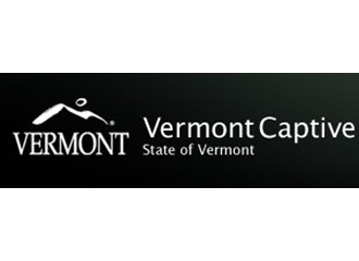 Vermont Captive mountain outline logo inside black box with contrasting white text